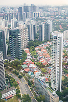 Urban Growth.  Singapore City View from Top of Ion Mall Looking West.   Highrise Apartment and Office Buildings Surround Lowrise Construction of an Earlier Era.