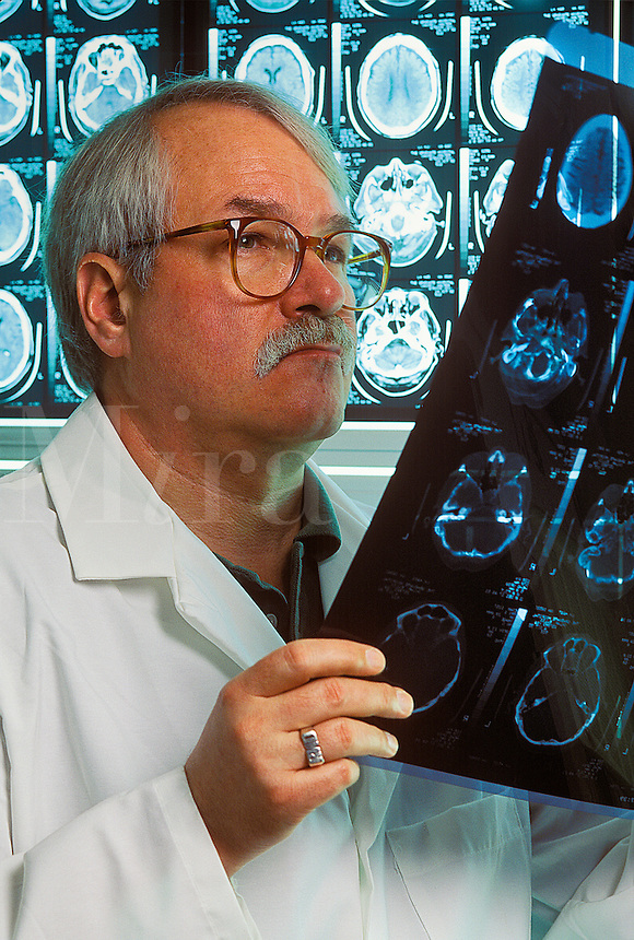 Docter reviews patient MRI.