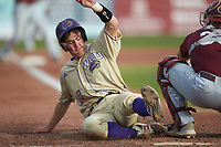 Daniel Walsh (19) of the Western Carolina Catamounts slides across home plate against the Saint Joseph's Hawks at TicketReturn.com Field at Pelicans Ballpark on February 23, 2020 in Myrtle Beach, South Carolina. The Hawks defeated the Catamounts 9-2. (Brian Westerholt/Four Seam Images)