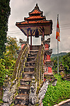 A bell tower has been constructed overlooking the valley below, at the edge of the Bramavihara-Arama Temple near Banjar (west of Singraja in the north of Bali).  This temple is one of the most impressive temples on the island of Bali.  It is free to visit.  It was overcast and occasionally rainy on the day we visited, making for even lighting and a dramatic sky.  (Bali, Indonesia; HDR Image.)