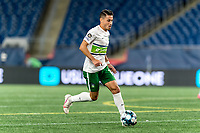 FOXBOROUGH, MA - AUGUST 26: Carlos Gomez #10 of Greenville Triumph SC dribbles at midfield during a game between Greenville Triumph SC and New England Revolution II at Gillette Stadium on August 26, 2020 in Foxborough, Massachusetts.