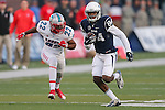 Nevada wide receiver Jerico Richardson runs past New Mexico safety Markel Byrd during the second half of an NCAA college football game in Reno, Nev., on Saturday, Oct. 10, 2015. Nevada won 35-17. (AP Photo/Cathleen Allison)
