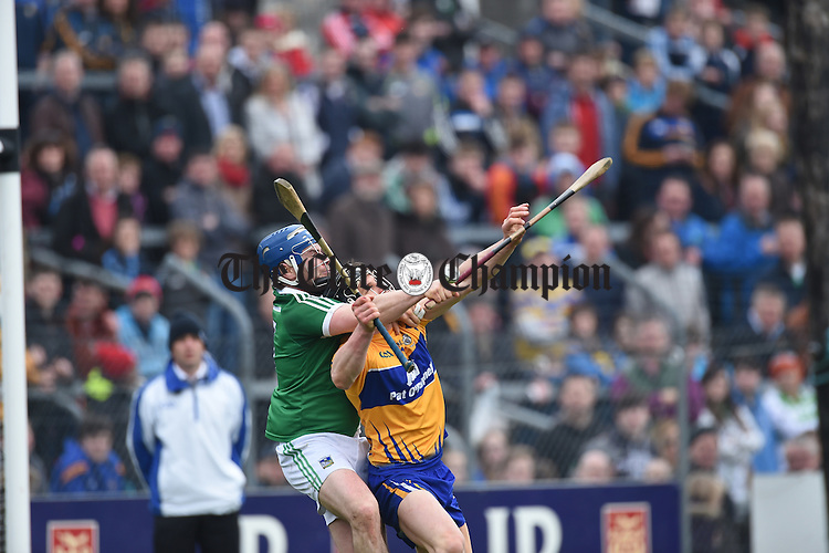 Richie Mc Carthy of Limerick in action against John Conlon of Clare during their Div. 1b Round 5 game in Cusack park. Photograph by John Kelly.
