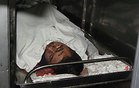 """A Palestinian Martyr  in Refrigerator at a hospital in Gaza City following an Israeli offensive, 27 June 2007.11 Palestinians were killed as Israel launched twin offensives in the Gaza Strip, triggering the deadliest violence since Hamas fighters overran the territory 12 days ago.""""photo By Fady Adwan"""""""