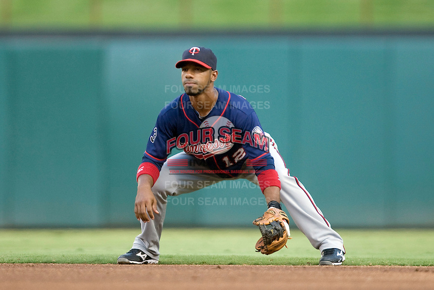 Minnesota Twins second baseman Alexi Casilla #12 on defense during a Major League Baseball game against the Texas Rangers at the Rangers Ballpark in Arlington, Texas on July 27, 2011. Minnesota defeated Texas 7-2.  (Andrew Woolley/Four Seam Images)