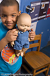 Education Preschool 3-4 year olds portrait of boy posing holding doll vertical