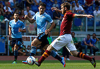 Calcio, Serie A: Roma vs Lazio. Roma, stadio Olimpico, 22 settembre 2013.<br /> AS Roma midfielder Daniele De Rossi, right, is challenged by Lazio midfielder Hernanes, of Brazil, during the Italian Serie A football match between AS Roma and Lazio, at Rome's Olympic stadium, 22 September 2013.<br /> UPDATE IMAGES PRESS/Riccardo De Luca