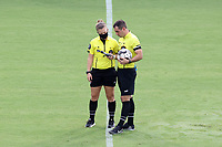 CARY, NC - AUGUST 01: Referee Kevin Broadley and Fourth Official Emma Richards check the wet bulb during a game between Birmingham Legion FC and North Carolina FC at Sahlen's Stadium at WakeMed Soccer Park on August 01, 2020 in Cary, North Carolina.