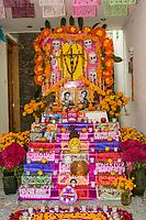 Oaxaca; Mexico; North America; Day of the Dead Celebrations.  Family Altar in the Courtyard of a Small Boutique Hotel, La Casa de las Bugambillas.
