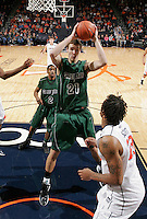 CHARLOTTESVILLE, VA- NOVEMBER 26:  Alec Brown #21 of the Green Bay Phoenix grabs a rebound during the game on November 26, 2011 at the John Paul Jones Arena in Charlottesville, Virginia. Virginia defeated Green Bay 68-42. (Photo by Andrew Shurtleff/Getty Images) *** Local Caption *** Alec Brown