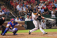 Baltimore Orioles third baseman Manny Machado #13 swings during the Major League Baseball game against the Texas Rangers on August 21st, 2012 at the Rangers Ballpark in Arlington, Texas. The Orioles defeated the Rangers 5-3. (Andrew Woolley/Four Seam Images).