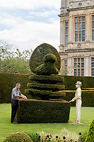 BNPS.co.uk (01202) 558833.<br /> Pic: ZacharyCulpin/BNPS<br /> <br /> Pictured: Longleat head gardener Jules Curtis clipping a topiary hedge in the shape of a peacock<br /> alongside a statue based on one of the Wiltshire estate's previous head gardeners from<br /> 1902.<br /> <br /> Life-size human sculptures have been unveiled at one of England's finest stately homes as part of an exhibition charting five centuries.<br /> <br /> The figures represent people and items from the late 16th century to the present day connected with Longleat House in Wiltshire.<br /> <br /> They include Jules Curtis, who was head gardener at the estate in the 1900s, clipping a topiary hedge.