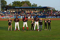 """Batavia Muckdogs Terry Bennett (33), Brayan Hernandez (41), and Ricardo Cespedes (47) stand with the """"Stars of the Game"""" during the national anthem before a game against the Auburn Doubledays on August 26, 2017 at Dwyer Stadium in Batavia, New York.  Batavia defeated Auburn 5-4.  (Mike Janes/Four Seam Images)"""