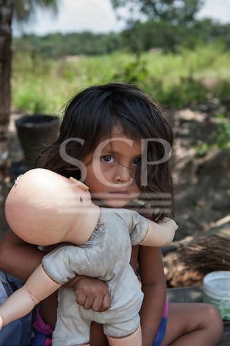 Xingu River, Para State, Brazil. The Volta Grande; Aldeia Terra Wangã da Volta Grande - Maia, Arara ethnic group. Girl playing with white doll.