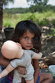 Xingu River, Para State, Brazil. The Volta Grande; Aldeia Terra Wangã da Volta Grande - Maia, Arara ethnic group. Girl playing with white doll.
