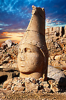 Picture & photo of the statues of around the tomb of Commagene King Antochus 1 on the top of Mount Nemrut, Turkey. Stock photos & Photo art prints. In 62 BC, King Antiochus I Theos of Commagene built on the mountain top a tomb-sanctuary flanked by huge statues (8–9 m/26–30 ft high) of himself, two lions, two eagles and various Greek, Armenian, and Iranian gods. The photos show the broken statues on the  2,134m (7,001ft)  mountain. 4