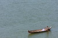 Myanmar, Burma.  Man in Boat on the Ayeyarwady (Irrawaddy) River, near Bagan.