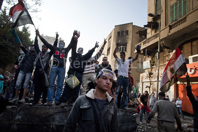"""Remi OCHLIK/IP3 -  Tahrir Square in Cairo November 23, 2011 -   Protesters take advantage of a cease fire and clean the streets Egypt's ruling military moved up the date for transferring power to a civilian government to July next year and consulted Tuesday with political parties on forming a new Cabinet. But the major concessions were immediately rejected by tens of thousands of protesters in Cairo's iconic Tahrir Square threatening a """"second revolution.  Egyptian troops moved into streets around the Interior Ministry in Cairo on Wednesday, replacing riot police who had repeatedly clashed with protesters trying to reach the building, an army officer said. Riot police withdrew inside the ministry. The removal of the widely hated police seemed to be part of efforts to calm violence that has killed more than 30 people and wounded 2,000 in Cairo and elsewhere in six days of protests targeting the ruling military council, not the army itself. The Interior Ministry, near Tahrir Square, has been the main flashpoint for clashes in which police have fired tear gas, pellets and rubber bullets at stone-throwing demonstrators."""