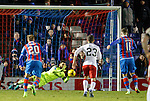 Wes Foderingham saves the penalty kick from Iain Vigurs