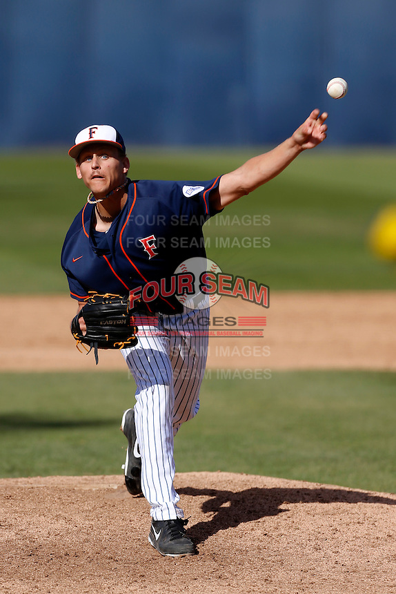 Tyler Peitzmeier #51 of the Cal State Fullerton Titans pitches against the Oregon Ducks at Goodwin Field on March 3, 2013 in Fullerton, California. (Larry Goren/Four Seam Images)