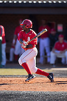 Lorenzo Wright (9) of the Belmont Abbey Crusaders follows through on his swing against the Shippensburg Raiders at Abbey Yard on February 8, 2015 in Belmont, North Carolina.  The Raiders defeated the Crusaders 14-0.  (Brian Westerholt/Four Seam Images)