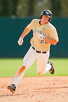 Jack Carey #20 of the Wake Forest Demon Deacons hustles around second base against the North Carolina State Wolfpack at Doak Field at Dail Park on March 17, 2012 in Raleigh, North Carolina.  The Wolfpack defeated the Demon Deacons 6-2.  (Brian Westerholt/Four Seam Images)