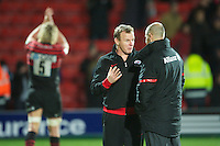 20121216 Copyright onEdition 2012©.Free for editorial use image, please credit: onEdition..Mark McCall, Saracens Director of Rugby, celebrates with substitute Charlie Hodgson of Saracens during the Heineken Cup Round 4 match between Saracens and Munster Rugby at Vicarage Road on Sunday 16th December 2012 (Photo by Rob Munro)..For press contacts contact: Sam Feasey at brandRapport on M: +44 (0)7717 757114 E: SFeasey@brand-rapport.com..If you require a higher resolution image or you have any other onEdition photographic enquiries, please contact onEdition on 0845 900 2 900 or email info@onEdition.com.This image is copyright onEdition 2012©..This image has been supplied by onEdition and must be credited onEdition. The author is asserting his full Moral rights in relation to the publication of this image. Rights for onward transmission of any image or file is not granted or implied. Changing or deleting Copyright information is illegal as specified in the Copyright, Design and Patents Act 1988. If you are in any way unsure of your right to publish this image please contact onEdition on 0845 900 2 900 or email info@onEdition.com