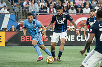 FOXBOROUGH, MA - SEPTEMBER 29: Tony Rocha #15 of New York City FC pressures Gustavo Bao #7 of New England Revolution during a game between New York City FC and New England Revolution at Gillettes Stadium on September 29, 2019 in Foxborough, Massachusetts.