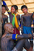 Pará State, Brazil. Aldeia Pukararankre (Kayapo). Cacique Kadjunhoro Kayapo and the boys.