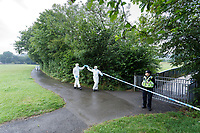 Pictured: Police forensics officers cross the cordon Lower Llansantffraid in Sarn near Bridgend, Wales, UK. Monday 02 August 2021 <br /> Re: South Wales Police can confirm that  three people have been arrested following reports of concerns for a missing 5 year old boy, named as Logan Williamson or Logan Mwangi, in Sarn, Bridgend, and the subsequent finding of the body in the Ogmore River near Pandy Park, Bridgend, Wales, UK.<br /> A 39 year male, 30 year female and 13 year old male, all from the Bridgend area, have been arrested on suspicion of murder and are currently in police custody.  We are not looking for anyone else in relation to this incident.