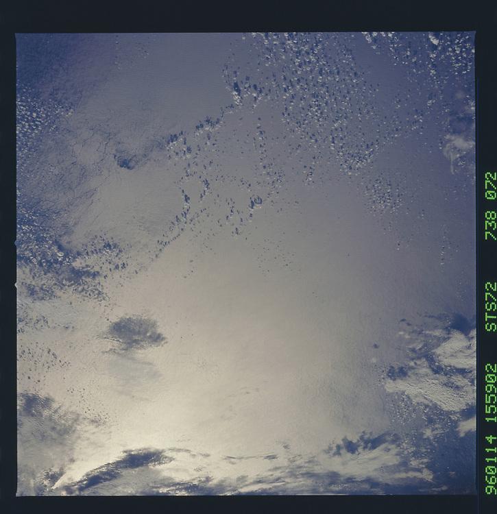 John Angerson. STS-72 Book.<br /> Public Domain Image.<br /> NASA images Courtesy National Archives - Record Group number: 255-STS-STS072<br /> Description: Earth observations taken from shuttle orbiter Endeavour during STS-72 mission.<br /> <br /> Subject Terms: STS-72, ENDEAVOUR (ORBITER), EARTH OBSERVATIONS (FROM SPACE), EARTH LIMB<br /> <br /> Date Taken: 1/14/1996<br /> <br /> Categories: Earth Observations<br /> <br /> Interior_Exterior: Exterior<br /> <br /> Ground_Orbit: On-orbit<br /> <br /> Original: Film - 70MM CT<br /> <br /> Preservation File Format: TIFF<br /> <br /> geon: PACIFIC OCEAN<br /> <br /> feat: INTERNAL WAVES, SUNGLINT, CLOUDS<br /> <br /> tilt: Low Oblique<br /> <br /> cldp: 25<br /> <br /> nlat: 9.4<br /> <br /> nlon: -120.5<br /> <br /> azi: 117<br /> <br /> alt: 167<br /> <br /> elev: 21