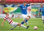 Hamilton Accies v St Johnstone...16.08.14  SPFL<br /> Scott Brown skips a tackle from Grant Gillespie<br /> Picture by Graeme Hart.<br /> Copyright Perthshire Picture Agency<br /> Tel: 01738 623350  Mobile: 07990 594431