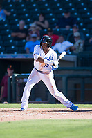 Surprise Saguaros center fielder Khalil Lee (15), of the Kansas City Royals organization, at bat during an Arizona Fall League game against the Salt River Rafters on October 9, 2018 at Surprise Stadium in Surprise, Arizona. Salt River defeated Surprise 10-8. (Zachary Lucy/Four Seam Images)