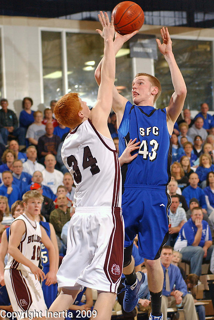 Sioux Falls, SD, March 10:   Sioux Falls Christian's # 43 Christian Skinner shoots over Madison's # 34 Tony Fiegen for two points during the second half, Tuesday night at the Elmen Center. (photo by Layne Jacoway/Inertia)