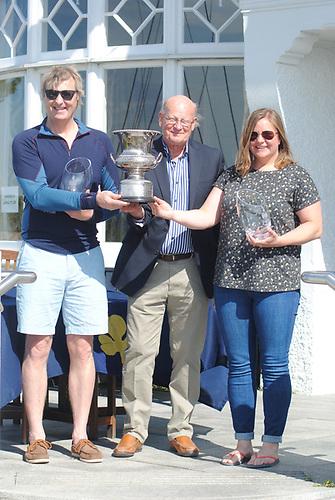 Greg Bell (left) with Commodore RNIYC Nigel Carson and Jayne Kearney Photo: Lindsay Nolan