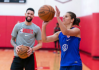 HOUSTON, TX - FEBRUARY 1: Carli Lloyd #10 of the United States takes a shot in front of Austin Rivers of the Houston Rockets at Houston Rockets Training Center on February 1, 2020 in Houston, Texas.