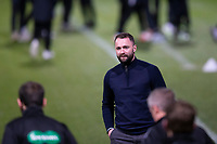 29th December 2020; Dens Park, Dundee, Scotland; Scottish Championship Football, Dundee FC versus Alloa Athletic; Dundee manager James McPake speaks to the match officials as they go out to inspect the pitch