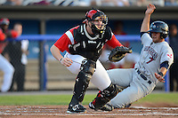 Batavia Muckdogs catcher Chad Wallach #55 waits for a throw as Josh McAdams #7 slides in during a game against the Mahoning Valley Scrappers on June 21, 2013 at Dwyer Stadium in Batavia, New York.  Batavia defeated Mahoning Valley 3-2.  (Mike Janes/Four Seam Images)