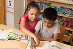 Education Elementary School Kindergarten mathematics using manipulatives, boy and girl interacting