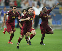 The Portuguese team, headed by Maniche (18), rush to join their goalkeeper (1) Ricardo at the end of the game.  Portugal defeated England on penalty kicks after playing to a 0-0 tie in regulation in their FIFA World Cup quarterfinal match at FIFA World Cup Stadium in Gelsenkirchen, Germany, July 1, 2006.