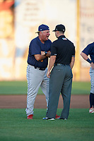 State College Spikes manager Joe Kruzel (13) argues a call with umpire Ben Rosen during a game against the Auburn Doubledays on August 21, 2017 at Falcon Park in Auburn, New York.  Kruzel was ejected from the game.  Auburn defeated State College 6-1.  (Mike Janes/Four Seam Images)