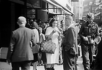 Photo from the NIOD's Huizinga collection. People are waiting at the Florencia ice cream shop in Torenstraat to be able to buy whipped cream there, The Hague.