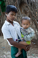 Myanmar, Burma.  Two Boys in a Burmese Village near Bagan.  The older boy has thanaka paste on his face, a cosmetic sunscreen.  Burman (Bamar) ethnic group.