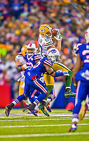 14 December 2014: Green Bay Packers wide receiver Jordy Nelson is tackled by Buffalo Bills safety Bacarri Rambo after gaining 20 yards on a pass-rush play in the fourth quarter at Ralph Wilson Stadium in Orchard Park, NY. The Bills defeated the Packers 21-13, snapping the Packers' 5-game winning streak and keeping the Bills' 2014 playoff hopes alive. Mandatory Credit: Ed Wolfstein Photo *** RAW (NEF) Image File Available ***
