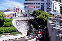 "Water Fountain at ""Waterfront Centre"" overlooking Cruise Ship docked at ""Canada Place"" Trade and Convention Centre and Cruise Ship Terminal, Vancouver, British Columbia, Canada"