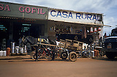 Altamira, Brazil. Hardware stores Casa Rural and Casa Gofil; mule and cart outside.