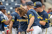Michigan Wolverines outfielder Jesse Franklin (7) is greeted by his teammates after his first inning home run in Game 6 of the NCAA College World Series against the Florida State Seminoles on June 17, 2019 at TD Ameritrade Park in Omaha, Nebraska. Michigan defeated Florida State 2-0. (Andrew Woolley/Four Seam Images)