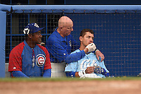 Daytona Cubs outfielder Albert Almora (6) is looked after by trainer Pete Fagan after leaving the game with a bloody nose and spitting blood as coach Mariano Duncan looks on during a game against the Dunedin Blue Jays on April 14, 2014 at Florida Auto Exchange Stadium in Dunedin, Florida.  Dunedin defeated Daytona 1-0  (Mike Janes/Four Seam Images)