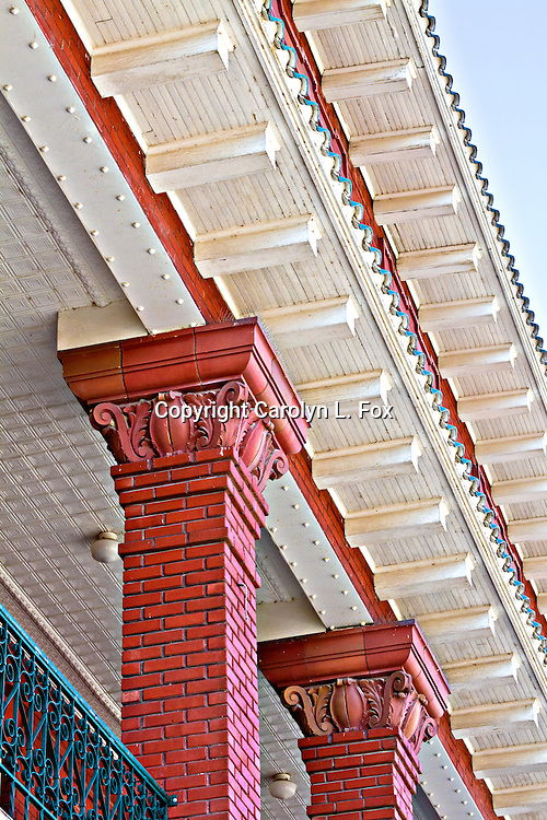 Gingerbread type architecture is seen on the top of an old building in Lexington, Missouri.