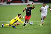 WASHINGTON, DC - AUGUST 25: Matt Turner #30 of New England Revolution battles for the ball with Ola Kamara #9 of D.C. United during a game between New England Revolution and D.C. United at Audi Field on August 25, 2020 in Washington, DC.